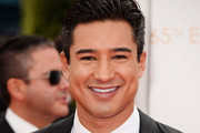 TV personality  Mario Lopez arrives at the 65th Annual Primetime Emmy Awards held at Nokia Theatre L.A. Live on September 22, 2013 in Los Angeles, California.