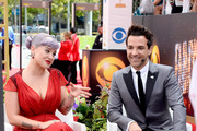 TV personalities Kelly Osbourne and George Kotsiopoulos attend the 65th Annual Primetime Emmy Awards held at Nokia Theatre L.A. Live on September 22, 2013 in Los Angeles, California.