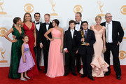 "(L-R) Actors Sarah Hyland, Aubrey Anderson-Emmons, Sofia Vergara, Ty Burrell, Jesse Tyler Ferguson, Ariel Winter, Nolan Gould, Eric Stonestreet, Rico Rodriguez, Julie Bowen and Ed O'Neill, winners of Outstanding Comedy Series for ""Modern Family,"" pose in the press room during the 65th Annual Primetime Emmy Awards held at Nokia Theatre L.A. Live on September 22, 2013 in Los Angeles, California."