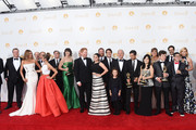 """Actors Sarah Hyland, Sofía Vergara, Aubrey Anderson-Emmons, Julie Bowen, Ariel Winter, Jesse Tyler Ferguson, Nolan Gould, Rico Rodriguez, Eric Stonestreet and Ed O'Neill with Show Producers, winners of the Outstanding Comedy Series Award for """"Modern Family"""" pose in the press room during the 66th Annual Primetime Emmy Awards held at Nokia Theatre L.A. Live on August 25, 2014 in Los Angeles, California."""