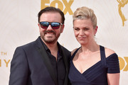 Actor Ricky Gervais (L) and Jane Fallon attend the 67th Emmy Awards at Microsoft Theater on September 20, 2015 in Los Angeles, California. 25720_001