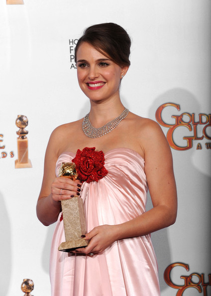 "Actor Natalie Portman poses with her award for Best Performance by an Actress in a Motion Picture (Drama) for ""Black Swan"" in the press room at the 68th Annual Golden Globe Awards held at The Beverly Hilton hotel on January 16, 2011 in Beverly Hills, California."