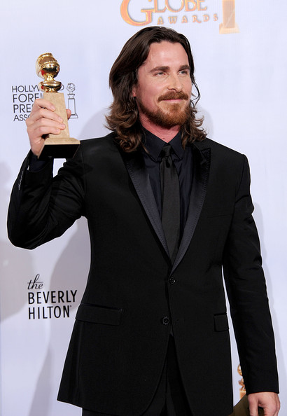 "Actor Christian Bale poses with his award for Best Performance by an Actress In A Supporting Role in a Motion Picture for ""The Fighter"" in the press room at the 68th Annual Golden Globe Awards held at The Beverly Hilton hotel on January 16, 2011 in Beverly Hills, California."