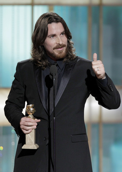 "In this handout photo provided by NBC, Actor Christian Bale accepts the Best Supporting Actor in a Motion Picture Award for ""The Fighter"" onstage during the Golden Globes at the Beverly Hilton International Ballroom on January 16, 2011 in Beverly Hills, California."