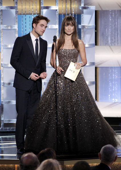 In this handout photo provided by NBC, presenters Robert Pattinson (L) and Olivia Wilde onstage during the Golden Globes at the Beverly Hilton International Ballroom on January 16, 2011 in Beverly Hills, California.