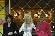 Lily Tomlin (L), Dolly Parton (C) and Jane Fonda arrive onstage during the 69th Emmy Awards at the Microsoft Theatre on September 17, 2017 in Los Angeles, California. / AFP PHOTO / Frederic J. Brown
