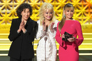 (L-R) Actors Lily Tomlin, Dolly Parton and Jane Fonda speak onstage during the 69th Annual Primetime Emmy Awards at Microsoft Theater on September 17, 2017 in Los Angeles, California.