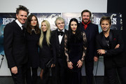 (L-R)  John Taylor, Atlanta De Cadenet Taylor, Gela Nash Taylor,Nick Rhodes, Nefer Suvio, Simon LeBon and Roger Taylor of Duran Duran attend the 'Duran Duran:  Unstaged' premiere during the 6th Annual MoMA Contenders Series at Museum of Modern Art on November 4, 2013 in New York City.