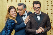 Image has been edited using digital filters) (L-R) Annie Murphy, Eugene Levy and Daniel Levy arrive at the 71st Emmy Awards at Microsoft Theater on September 22, 2019 in Los Angeles, California.