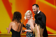 Michelle Williams (C) walks offstage with Tony Hale (back R) and Julia Louis-Dreyfus (R) after Ms. Williams accepted the Outstanding Lead Actress in a Limited Series or Movie award for 'Fosse/Verdon' onstage during the 71st Emmy Awards at Microsoft Theater on September 22, 2019 in Los Angeles, California.