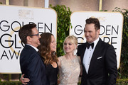 (L-R) Actor Robert Downey, Jr., producer Susan Downey, actress Anna Faris and actor Chris Pratt attend the 72nd Annual Golden Globe Awards at The Beverly Hilton Hotel on January 11, 2015 in Beverly Hills, California.