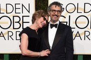 John Turturro (R) and Katherine Borowitz arrive at the 74th annual Golden Globe Awards, January 8, 2017, at the Beverly Hilton Hotel in Beverly Hills, California.  / AFP / VALERIE MACON