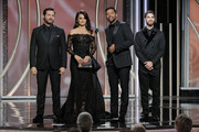 In this handout photo provided by NBCUniversal,  Presenters Edgar Ramirez, Penelope Cruz, Ricky Martin and Darren Criss speak onstage during the 75th Annual Golden Globe Awards at The Beverly Hilton Hotel on January 7, 2018 in Beverly Hills, California.