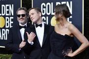 (L-R) Joaquin Phoenix, Taron Egerton and Emily Thomas attend the 77th Annual Golden Globe Awards at The Beverly Hilton Hotel on January 05, 2020 in Beverly Hills, California.