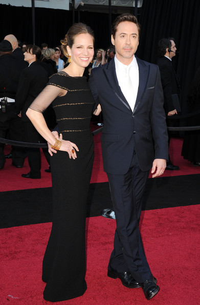 Actor Robert Downey Jr. (R) and producer Susan Downey arrive at the 83rd Annual Academy Awards held at the Kodak Theatre on February 27, 2011 in Hollywood, California.