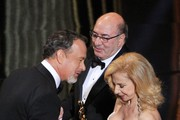 Art directors Dante Ferretti (C) and Francesca Lo Schiavo (R) accept Best Achievement in Art Direction award for 'Hugo' from presenter Tom Hanks (L) onstage during the 84th Annual Academy Awards held at the Hollywood & Highland Center on February 26, 2012 in Hollywood, California.