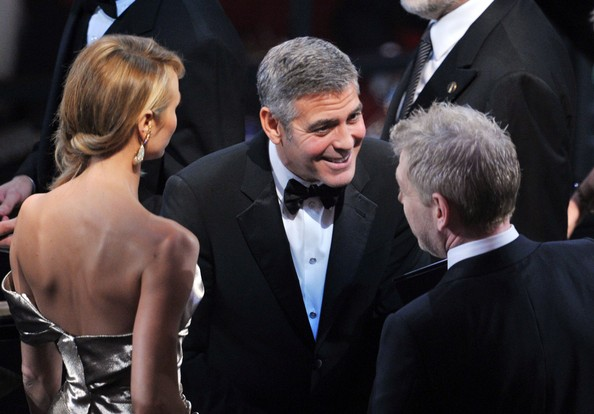 (L-R) Stacy Kiebler, actor George Clooney and actor Kenneth Branagh attend the 84th Annual Academy Awards held at the Hollywood & Highland Center on February 26, 2012 in Hollywood, California.