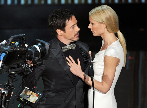 Presenters Robert Downey Jr. (L) and Gwyneth Paltrow speak onstage during the 84th Annual Academy Awards held at the Hollywood & Highland Center on February 26, 2012 in Hollywood, California.