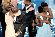 (L-R) Actress Sarah Paulson, director Steve McQueen, producer Arnon Milchan, actresses Lupita Nyong'o and Adepero Oduye accept the Best Picture award for '12 Years a Slave' from actor Will Smith (C) onstage during the Oscars at the Dolby Theatre on March 2, 2014 in Hollywood, California.