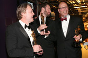 (L-R) Don Hall, Roy Conli and Chris Williams, winners of the Best Animated Feature Award for 'Big Hero 6',' attend the 87th Annual Academy Awards at Dolby Theatre on February 22, 2015 in Hollywood, California.