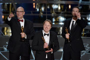 """Director Don Hall (c) accepts the Best Animated Feature Award for """"Big Hero 6"""" with Chris Williams and Roy Conli onstage during the 87th Annual Academy Awards at Dolby Theatre on February 22, 2015 in Hollywood, California."""
