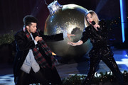 Jordan Fisher and Julianne Hough perform onstage at the 87th Annual Rockefeller Center Christmas Tree Lighting Ceremony at Rockefeller Center on December 04, 2019 in New York City.