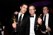Josh Singer and Tom McCarthy (R), winners of the award for Best Original Screenplay for 'Spotlight,' attend the 88th Annual Academy Awards Governors Ball at Hollywood & Highland Center on February 28, 2016 in Hollywood, California.