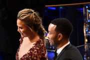 Model Chrissy Teigen and musician John Legend in the audience during the 88th Annual Academy Awards at the Dolby Theatre on February 28, 2016 in Hollywood, California.