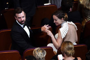 Actors Jason Sudeikis and Olivia Wilde in the audience during the 88th Annual Academy Awards at the Dolby Theatre on February 28, 2016 in Hollywood, California.