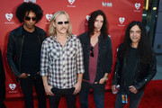 (L-R) Musicians William DuVall, Jerry Cantrell, Sean Kinney and Mike Inez of the band Alice in Chains arrive at the 8th Annual MusiCares MAP Fund Benefit at Club Nokia on May 31, 2012 in Los Angeles, California. The MusiCares MAP Fund benefit raises resources for the MusiCares MAP Fund, which provides members of the music community access to addiction recovery treatment. More information at musicares.org.