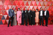 "Director Luca Guadagnino (L) and crew of ""Call Me by Your Name"" attend the 90th Annual Academy Awards at Hollywood & Highland Center on March 4, 2018 in Hollywood, California."