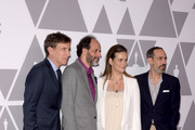 (L-R) Producer Peter Spears, director Luca Guadagnino, and producers Emilie Georges and Marco Morabito attend the 90th Annual Academy Awards Nominee Luncheon at The Beverly Hilton Hotel on February 5, 2018 in Beverly Hills, California.