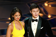 Actors Eiza Gonzalez (L) and Ansel Elgort speak onstage during the 90th Annual Academy Awards at the Dolby Theatre at Hollywood & Highland Center on March 4, 2018 in Hollywood, California.