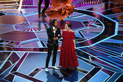 Singers Miguel (L) and Natalia Lafourcade perform onstage during the 90th Annual Academy Awards at the Dolby Theatre at Hollywood & Highland Center on March 4, 2018 in Hollywood, California.