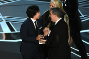 (L-R) Actor Anthony Gonzalez, co-director Lee Unkrich, and producer Darla K. Anderson accept Best Animated Feature Film for 'Coco' onstage during the 90th Annual Academy Awards at the Dolby Theatre at Hollywood & Highland Center on March 4, 2018 in Hollywood, California.