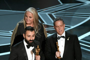 (L-R) Filmmakers Adrian Molina, Darla K. Anderson and Lee Unkrich accept Best Animated Feature Film for 'Coco' onstage during the 90th Annual Academy Awards at the Dolby Theatre at Hollywood & Highland Center on March 4, 2018 in Hollywood, California.