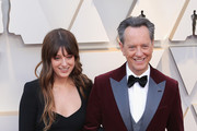 Richard E. Grant (R) and Olivia Grant attends the 91st Annual Academy Awards at Hollywood and Highland on February 24, 2019 in Hollywood, California.