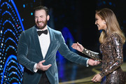 In this handout provided by A.M.P.A.S., presenters Chris Evans and Jennifer Lopez speak onstage during the 91st Annual Academy Awards at the Dolby Theatre on February 24, 2019 in Hollywood, California.