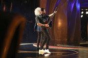 In this handout provided by A.M.P.A.S., Brian May and Adam Lambert perform with Queen onstage during the 91st Annual Academy Awards at the Dolby Theatre on February 24, 2019 in Hollywood, California.