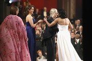 """In this handout provided by A.M.P.A.S., Presenters Maya Rudolph, Tina Fey and Amy Poehler present Regina King with the Actress In A Supporting Role award for """"If Beale Street Could Talk""""  during the 91st Annual Academy Awards at the Dolby Theatre on February 24, 2019 in Hollywood, California."""