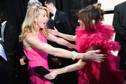 In this handout provided by A.M.P.A.S., After 'Green Book' was awarded Best Picture, Julia Roberts hugs Linda Cardellini backstage during the 91st Annual Academy Awards at the Dolby Theatre on February 24, 2019 in Hollywood, California.