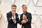 (L-R) Producer Carthew Neal and filmmaker Taika Waititi attend the 92nd Annual Academy Awards at Hollywood and Highland on February 09, 2020 in Hollywood, California.