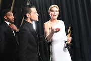 In this handout photo provided by A.M.P.A.S. Rami Malek and Best Actress award winner Renée Zellweger speak backstage during the 92nd Annual Academy Awards at the Dolby Theatre on February 09, 2020 in Hollywood, California.