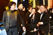 In this handout photo provided by A.M.P.A.S. Best Picture award winners Bong Joon Ho and Kwak Sin-ae walk backstage during the 92nd Annual Academy Awards at the Dolby Theatre on February 09, 2020 in Hollywood, California.