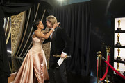 In this handout photo provided by A.M.P.A.S. Regina King and Best Actor in a Supporting Role winner Brad Pitt embrace backstage during the 92nd Annual Academy Awards at the Dolby Theatre on February 09, 2020 in Hollywood, California.