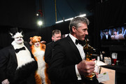In this handout photo provided by A.M.P.A.S. James Corden, Rebel Wilson, and Visual Effects award winners Greg Butler and Dominic Tuohy walk backstage during the 92nd Annual Academy Awards at the Dolby Theatre on February 09, 2020 in Hollywood, California.