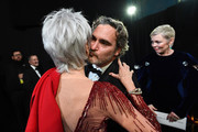 In this handout photo provided by A.M.P.A.S. Jane Fonda and Best Actor award winner Joaquin Phoenix enbrace backstage during the 92nd Annual Academy Awards at the Dolby Theatre on February 09, 2020 in Hollywood, California.
