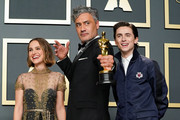 "L-R) Natalie Portman, Taika Waititi, winner of the Adapted Screenplay award for ""Jojo Rabbit,"" and Timothée Chalamet pose in the press room during 92nd Annual Academy Awards at Hollywood and Highland on February 09, 2020 in Hollywood, California."
