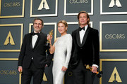 """(L-R) Joaquin Phoenix, winner of the Actor in a Leading Role award for """"Joker,"""" Renée Zellweger, winner of the Actress in a Leading Role award for """"Judy,"""" and Brad Pitt, winner of the Actor in a Supporting Role award for """"Once Upon a Time in Hollywood,"""" pose in the press room during the 92nd Annual Academy Awards at Hollywood and Highland on February 09, 2020 in Hollywood, California."""