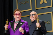 """Elton John and Bernie Taupin, winners of Best Original Song for """"(I'm Gonna) Love Me Again, 'Rocketman'"""", pose in the press room during 92nd Annual Academy Awards at Hollywood and Highland on February 09, 2020 in Hollywood, California."""